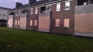 photo showing how a block of flats looked before work commenced