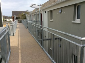 Photo showing new walkway with resin bond finish and new external insulation finish